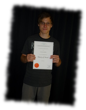 Photo of student who received a high distinction in their theory exam